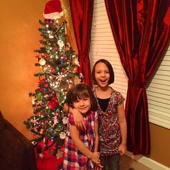 The girls with their Christmas tree.